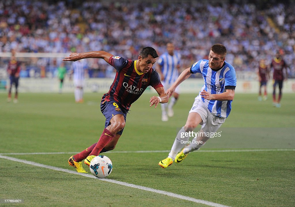 Adriano Correia (L) of FC Barcelona is challenged by Vitorino Antunes of Malaga CF during the La Liga match between Malaga CF and FC Barcelona at La Rosaleda Stadium on August 25, 2013 in Malaga, Spain.