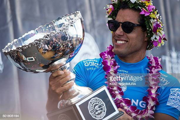 Adriano de Souza holds up his trophy after winning the surfing Pipeline Masters event of the Vans Triple Crown at Ehukai Beach Park in Haleiwa Hawaii...