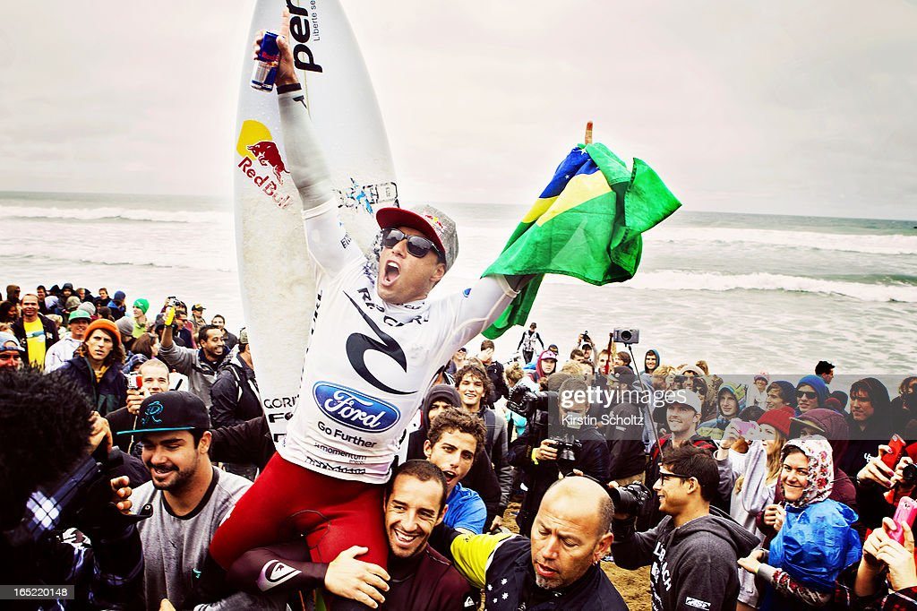 Adriano De Souza of Brasil celebrates his victory as he is carried up the beach after winning the Rip Curl Pro on April 2, 2013 in Bells Beach, Australia.
