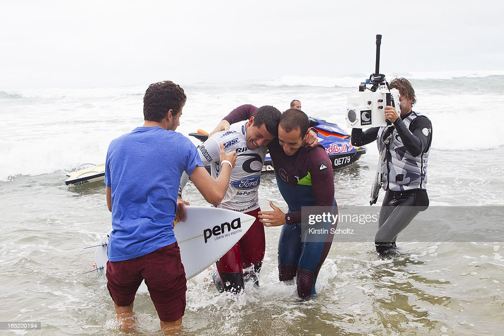 Adriano De Souza of Brasil celebrates his victory with friends Tiago Pires of Portugal (right) and Felipe Toledo of Brasil (left) at the Rip Curl Pro on April 2, 2013 in Bells Beach, Australia.