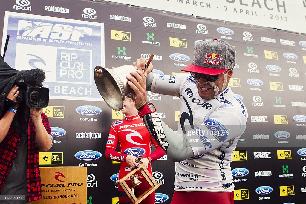 Adriano De Souza of Brasil rings the bell after it has broken off the trophy during prizegiving after winning the Rip Curl Pro on April 2, 2013 in Bells Beach, Australia.