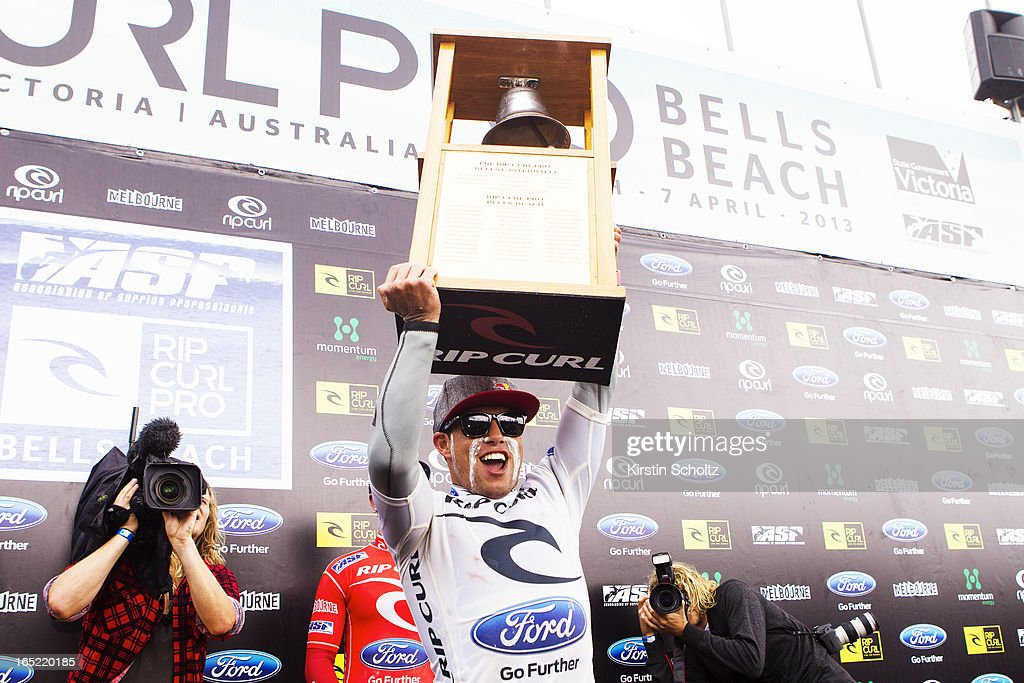 Adriano De Souza of Brasil rings the bell during prizegiving after winning the Rip Curl Pro on April 2, 2013 in Bells Beach, Australia.