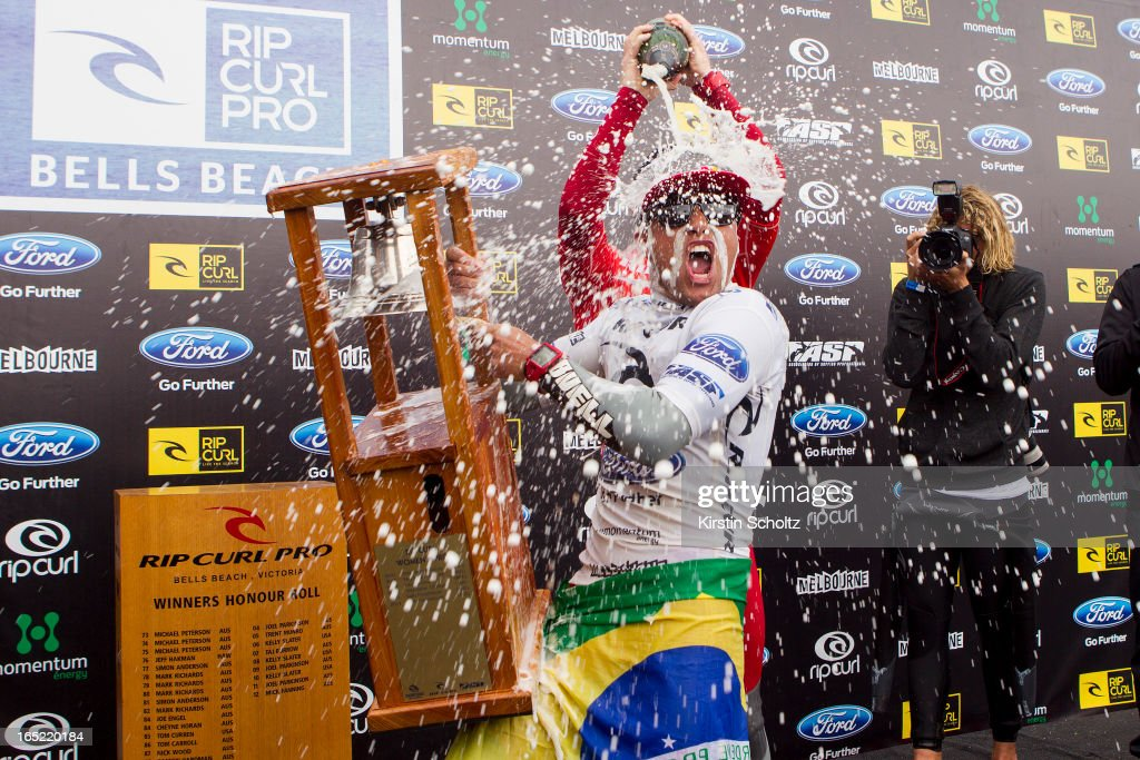 Adriano De Souza of Brasil rings the bell during prizegiving as Nat Young of the United States of America pours champaign over him at the Rip Curl Pro on April 2, 2013 in Bells Beach, Australia.