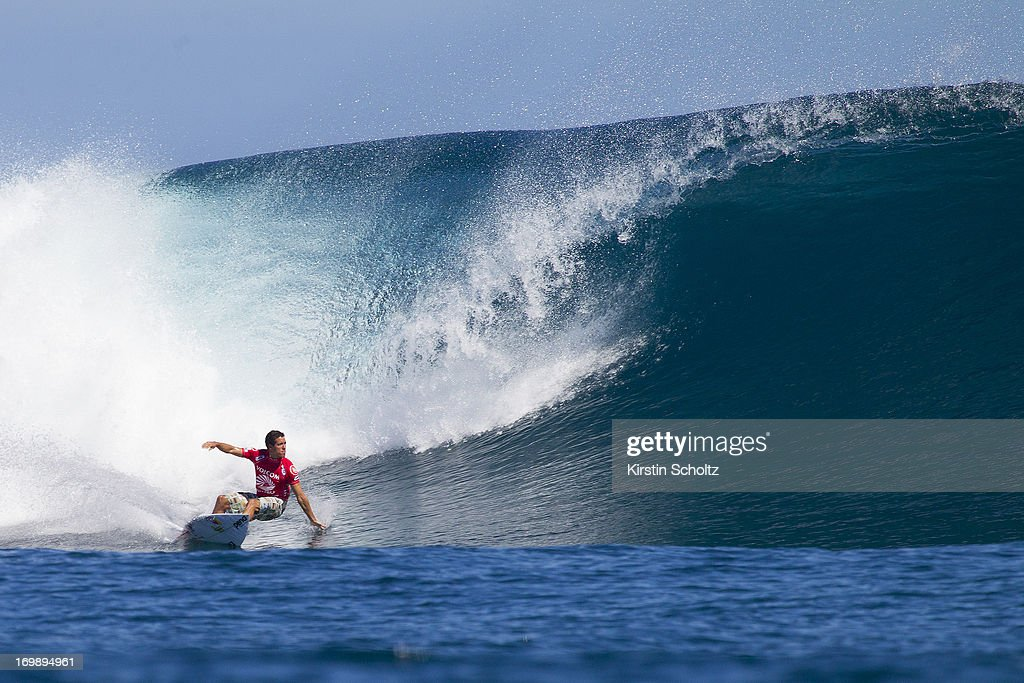 <a gi-track='captionPersonalityLinkClicked' href=/galleries/search?phrase=Adriano+de+Souza&family=editorial&specificpeople=624048 ng-click='$event.stopPropagation()'>Adriano de Souza</a> of Brasil surfs during round one of the Volcom Fiji Pro on June 4, 2013 in Tavarua, Fiji.