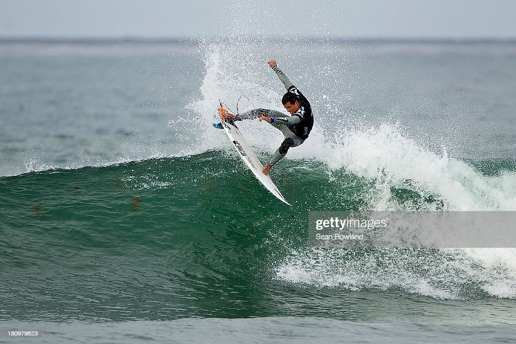 Adriano DeSouza of Brazil surfs during round five at The Hurley Pro on September 18, 2013 in San Diego, California.