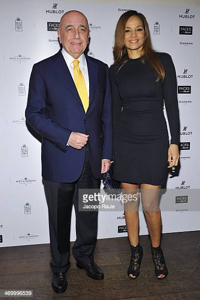Adriano Galliani and his wife Helga Costa attend 'The Faces' Opening Exhibition on February 17 2014 in Milan Italy