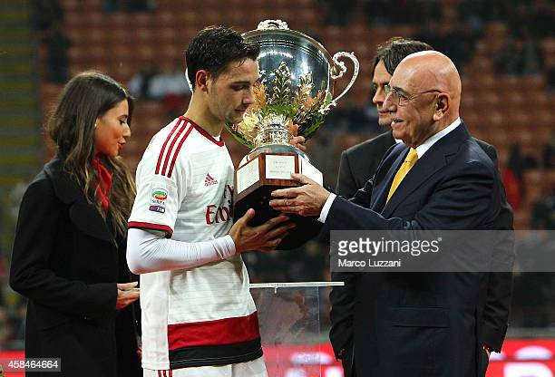 Adriano Galliani give the trophy to Mattia De Sciglio of AC Milan lifts the trophy following the Luigi Berlusconi Trophy at Stadio Giuseppe Meazza on...