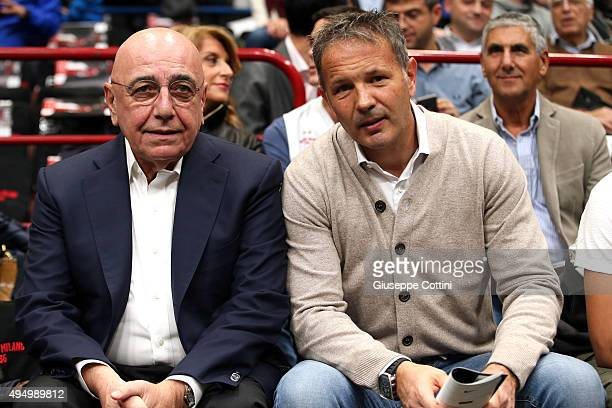 Adriano Galliani Vice President of AC Milan and Sinisa Mihajlovic Coach of AC Milan during attends the Turkish Airlines Euroleague Regular Season...