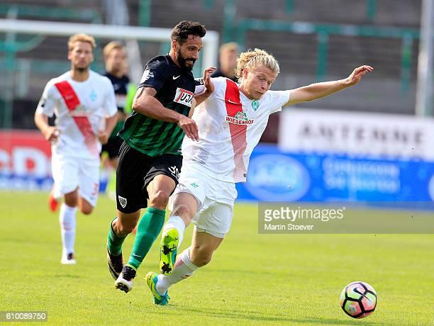 Adriano Grimaldi of Muenster challenges Jesper Verlaat of Bremen II during the Third Leagie match between Preussen Muenster and Werder Bremen II at...