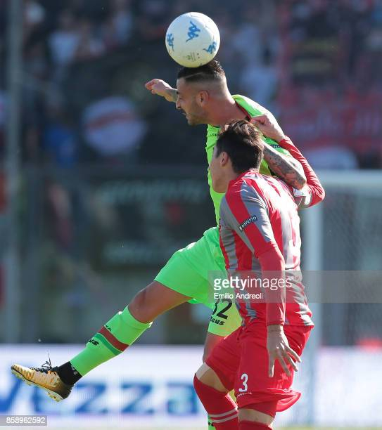 Adriano Montalto of Ternana Calcio jumps for the ball with Claiton Dos Santos Machado of US Cremonese during the Serie B match between US Cremonese...