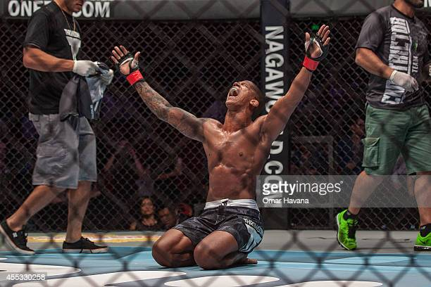 Adriano Moraes celebrates his victory against Geje Eustaquio for the Flyweight World Championship during One FC Cambodia on September 12 2014 in...