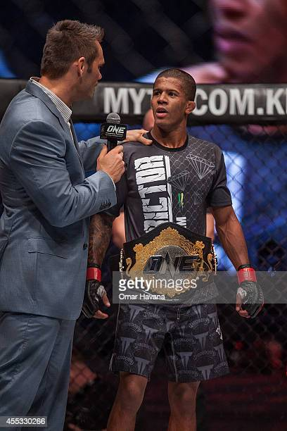Adriano Moraes is interviewed after winning the Flyweight World Championship against Geje Eustaquio during One FC Cambodia on September 12 2014 in...