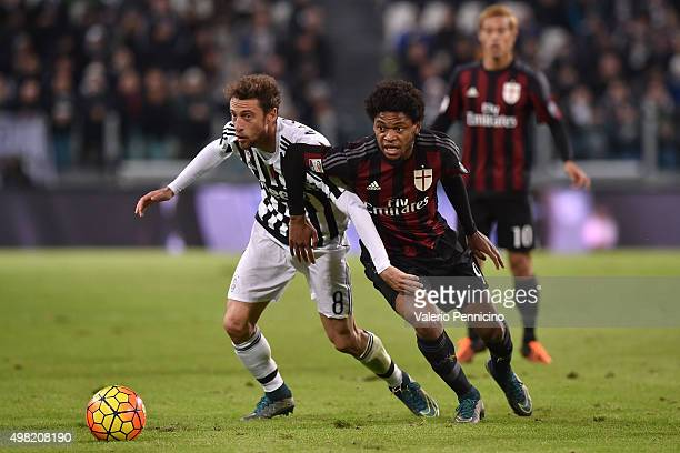 Adriano of AC Milan competes with Claudio Marchisio of Juventus FC during the Serie A match between Juventus FC and AC Milan at Juventus Arena on...
