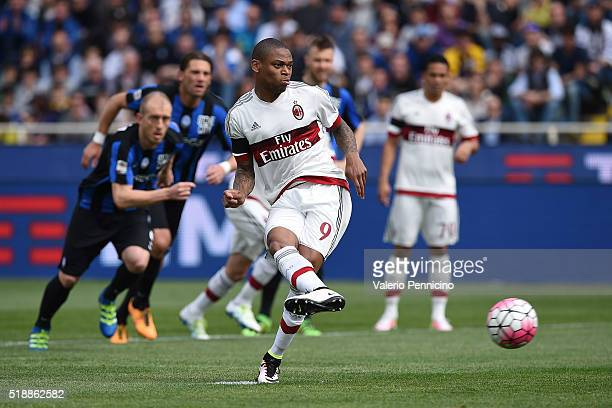 Adriano of AC Milan scores the opening goal from the penalty spot during the Serie A match between Atalanta BC and AC Milan at Stadio Atleti Azzurri...