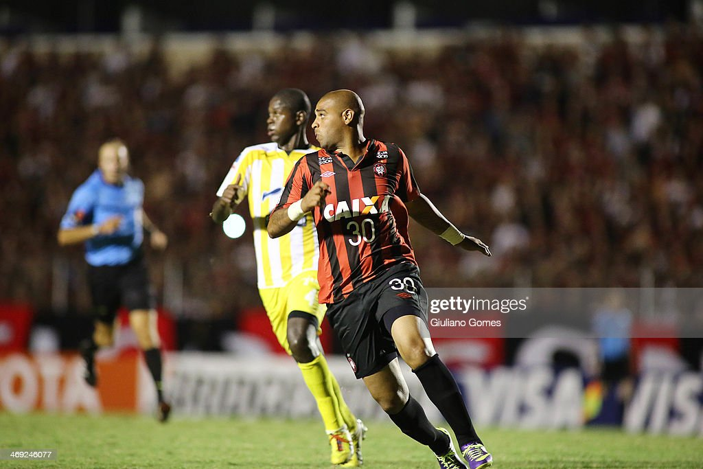 Adriano (R) of Atletico Paranaense battles for the ball against Jefferson Lopez of The Strongest during a match between Atletico Paranaense and The Strongest as part of Copa Bridgestone Libertadores 2014 at Durival Britto Stadium on February 13, 2014 in Curitiba, Parana, Brazil.