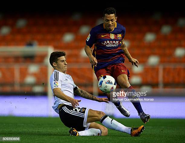 Adriano of Barcelona is tackled by Santi Mina of Valencia during the Copa del Rey Semi Final second leg match between Valencia CF and FC Barcelona at...