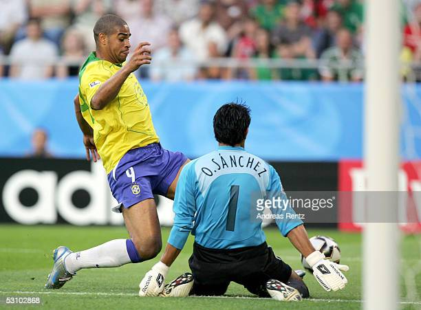 Adriano of Brazil is denied by goalkeeper Oswaldo Sanchez of Mexico during the FIFA Confederations Cup 2005 match between Mexico and Brazil on June...