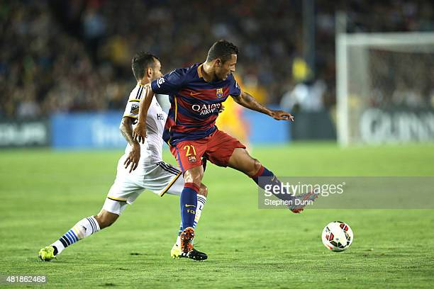 Adriano of FC Barcelona controls the ball against Juninho of the Los Angeles Galaxy in the International Champions Cup 2015 at Rose Bowl on July 21...