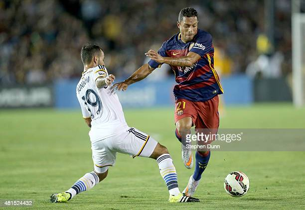 Adriano of FC Barcelona fights for the ball with Juninho of the Los Angeles Galaxy in the International Champions Cup 2015 at Rose Bowl on July 21...