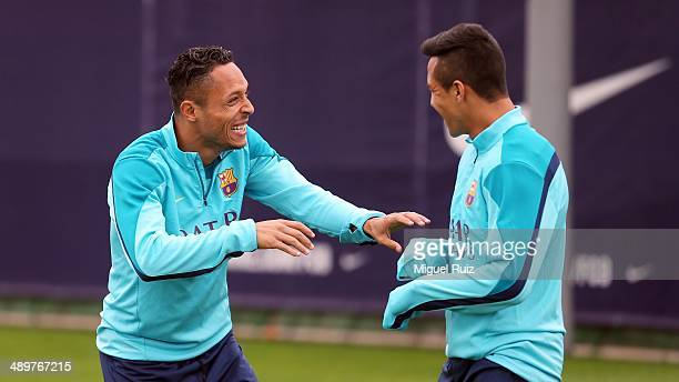 Adriano of FC Barcelona jokes with his teammate Alexis Sanchezl during the training session at Ciutat Esportiva on May 12 2014 in Barcelona Spain