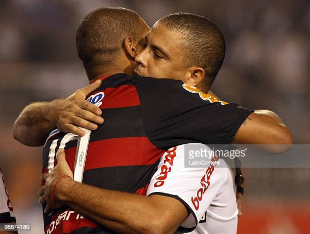 Adriano of Flamengo embraces Ronaldo Nazario of Corinthians prior to their Libertadores Cup match at Pacaembu stadium on May 5 2010 in Sao Paulo...