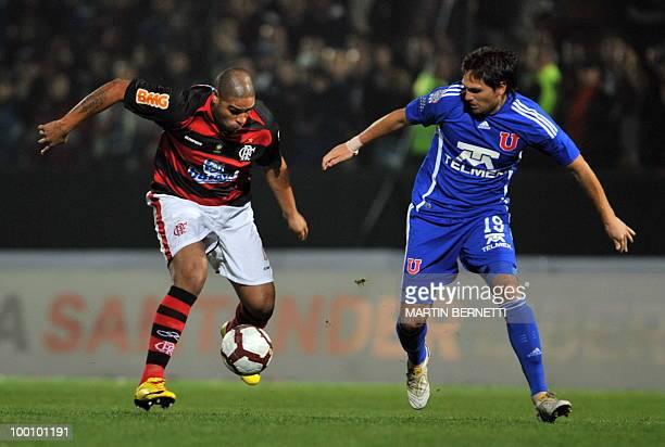 Adriano of Flamengo vies for the ball with Universidad de Chile's Rafael Olarra during their Copa Libertadores football match at Santa Laura stadium...