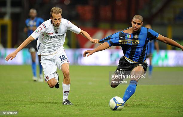 Adriano of Inter Milan and Claudio Terzi of Bologna in action during the Serie A match between FC Inter Milan and Bologna FC at the Stadio Meaazza on...