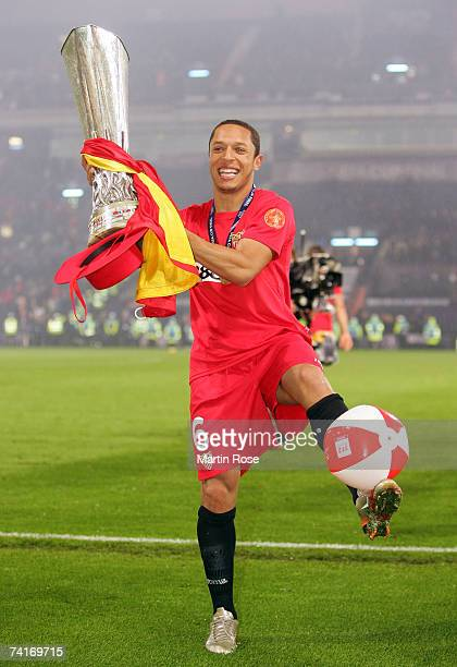 Adriano of Sevilla poses with the trophy after his team's victory in a penalty shootout at the end of the UEFA Cup Final between Espanyol and Sevilla...