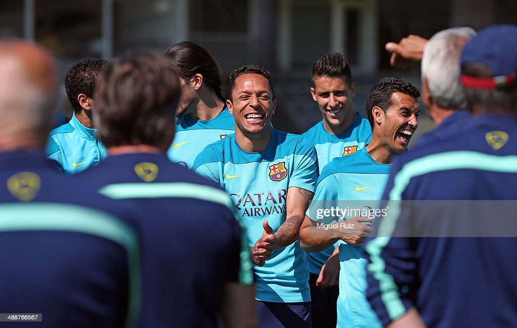 Adriano (C), Pedro Rodriguez and <a gi-track='captionPersonalityLinkClicked' href=/galleries/search?phrase=Cristian+Tello&family=editorial&specificpeople=8014696 ng-click='$event.stopPropagation()'>Cristian Tello</a> of FC Barcelona laugh during the training session at Ciutat Esportiva on May 8, 2014 in Barcelona, Spain.