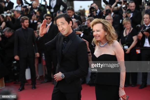 Adrien Brody and Caroline Scheufele arrive at red carpet of the Closing Ceremony during the 70th annual Cannes Film Festival at Palais des Festivals...