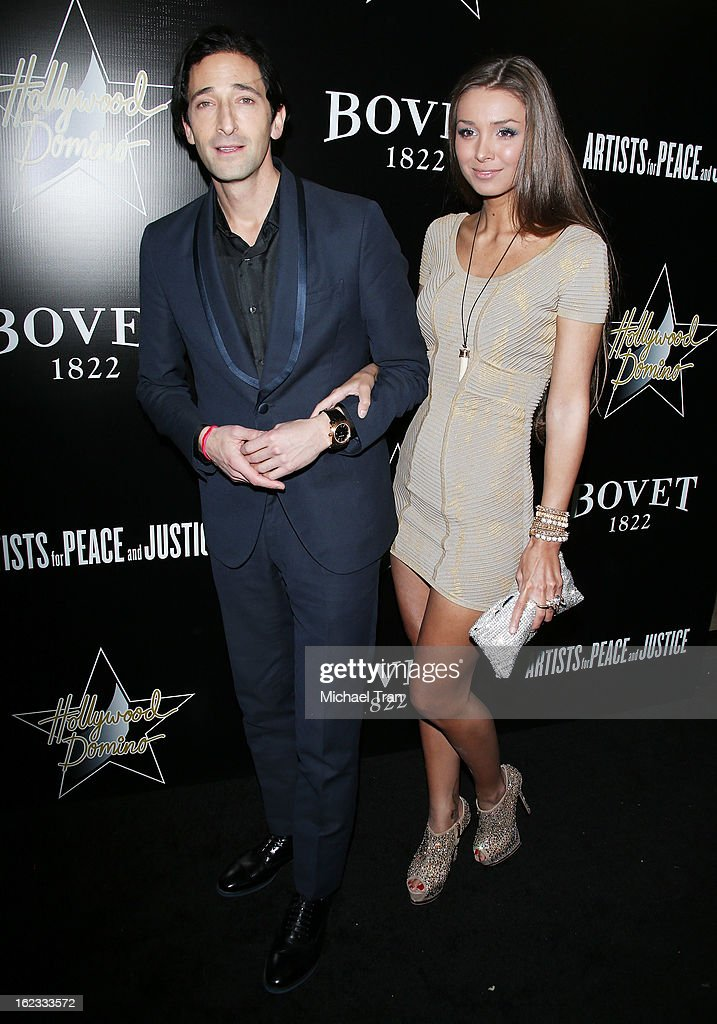 <a gi-track='captionPersonalityLinkClicked' href=/galleries/search?phrase=Adrien+Brody&family=editorial&specificpeople=202175 ng-click='$event.stopPropagation()'>Adrien Brody</a> (L) and guest arrive at the 6th Annual Hollywood Domino Pre-Oscar Gala & Tournament held at Sunset Tower on February 21, 2013 in West Hollywood, California.