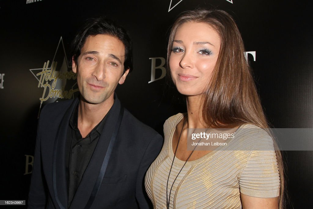 Adrien Brody and guest attend the Hollywood Domino And Bovet 1822 Gala Benefiting Artists For Peace And Justice at Sunset Tower on February 21, 2013 in West Hollywood, California.