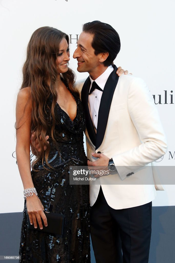 <a gi-track='captionPersonalityLinkClicked' href=/galleries/search?phrase=Adrien+Brody&family=editorial&specificpeople=202175 ng-click='$event.stopPropagation()'>Adrien Brody</a> (R) and Lara Leito arrive at amfAR's 20th Annual Cinema Against AIDS at Hotel du Cap-Eden-Roc on May 23, 2013 in Cap d'Antibes, France.