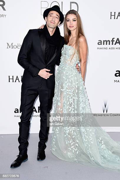 Adrien Brody and Lara Leito arrive at amfAR's 23rd Cinema Against AIDS Gala at Hotel du CapEdenRoc on May 19 2016 in Cap d'Antibes France