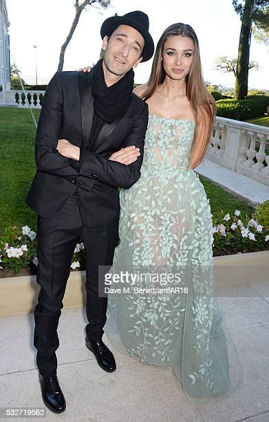 Adrien Brody and Lara Leito attend amfAR's 23rd Cinema Against AIDS Gala at Hotel du CapEdenRoc on May 19 2016 in Cap d'Antibes France