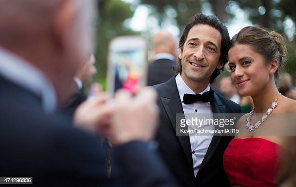 Adrien Brody and Lara Leito attend the amfAR 22nd Annual Cinema Against AIDS Gala at Hotel du CapEdenRoc on May 21 2015 in Cap d'Antibes France
