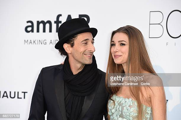 Adrien Brody and Lara Leito attend the amfAR's 23rd Cinema Against AIDS Gala Dinner at the annual 69th Cannes Film Festival at Hotel du CapEdenRoc on...