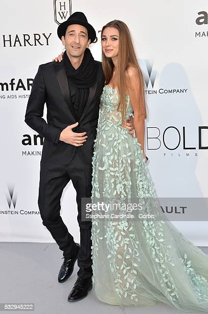 Adrien Brody and Lara Leito attend the amfAR's 23rd Cinema Against AIDS Gala at the annual 69th Cannes Film Festival at Hotel du CapEdenRoc on May 19...
