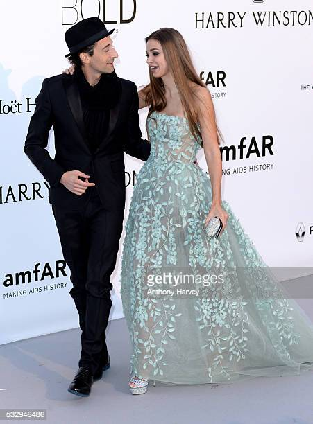 Adrien Brody and Lara Leito attend the amfAR's 23rd Cinema Against AIDS Gala at Hotel du CapEdenRoc on May 19 2016 in Cap d'Antibes France