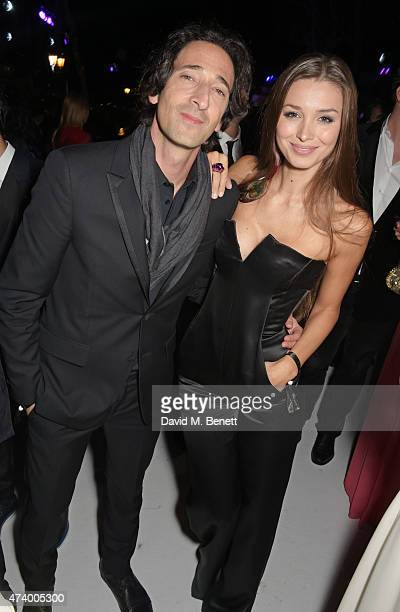 Adrien Brody and Lara Leito attend the de Grisogono 'Divine In Cannes' party at Hotel du CapEdenRoc on May 19 2015 in Cap d'Antibes France