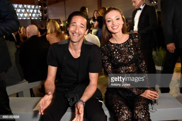 Adrien Brody and Lara Lieto attend the Fashion for Relief event during the 70th annual Cannes Film Festival at Aeroport Cannes Mandelieu on May 21...