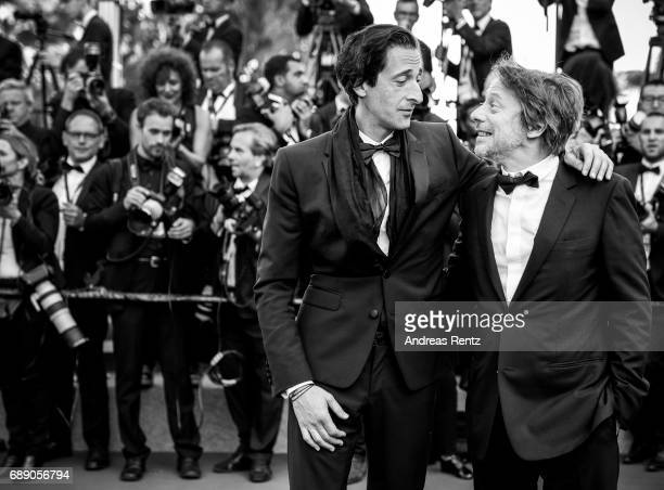 Adrien Brody and Mathieu Amalric attend the 'Based On A True Story' screening during the 70th annual Cannes Film Festival at Palais des Festivals on...