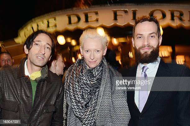 Adrien Brody Tilda Swinton and Sandro Kopp attend the Bulgari And Purple Magazine Party at Cafe de Flore on March 3 2013 in Paris France
