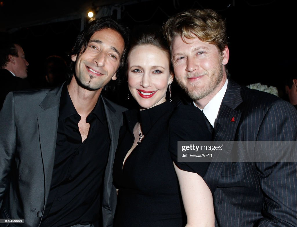 <a gi-track='captionPersonalityLinkClicked' href=/galleries/search?phrase=Adrien+Brody&family=editorial&specificpeople=202175 ng-click='$event.stopPropagation()'>Adrien Brody</a>, <a gi-track='captionPersonalityLinkClicked' href=/galleries/search?phrase=Vera+Farmiga&family=editorial&specificpeople=227012 ng-click='$event.stopPropagation()'>Vera Farmiga</a> and <a gi-track='captionPersonalityLinkClicked' href=/galleries/search?phrase=Renn+Hawkey&family=editorial&specificpeople=3853255 ng-click='$event.stopPropagation()'>Renn Hawkey</a> attend the 2011 Vanity Fair Oscar Party Hosted by Graydon Carter at the Sunset Tower Hotel on February 27, 2011 in West Hollywood, California.