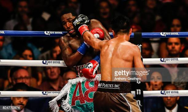 Adrien Broner and Mikey Garcia exchange punches during their Junior Welterwight bout on July 29 2017 at the Barclays Center in the Brooklyn borough...