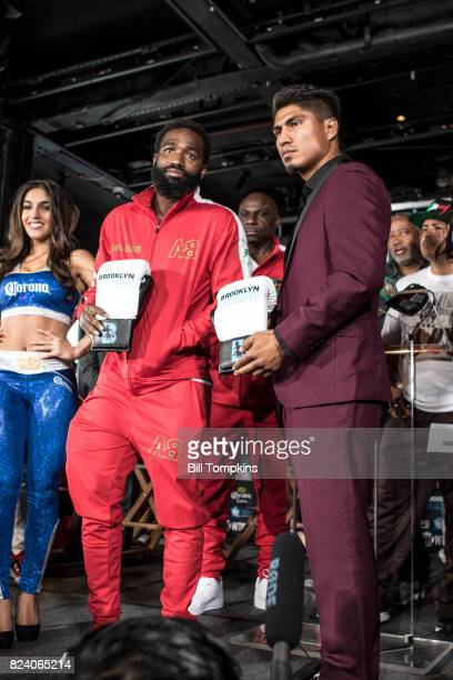 Adrien Broner and Mikey Garcia pose during the Adrien Broner vs Mikey Garcia Final Press Conference at the Dream Hotel July 27 2017 in New York City