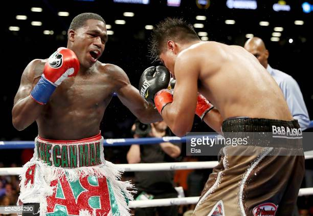 Adrien Broner hits Mikey Garcia during their Junior Welterwight bout on July 29 2017 at the Barclays Center in the Brooklyn borough of New York City