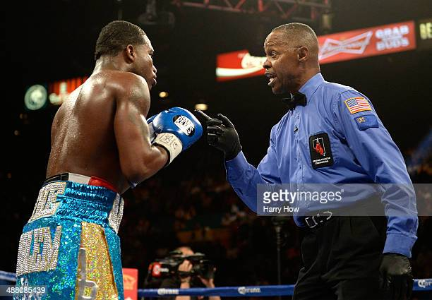 Adrien Broner is warned by the referee Kenny Bayless for flipping Carlos Molina during their super lightweight bout at the MGM Grand Garden Arena on...