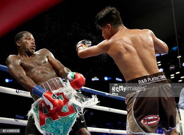 Adrien Broner moves to miss a shot by Mikey Garcia during their Junior Welterwight bout on July 29 2017 at the Barclays Center in the Brooklyn...