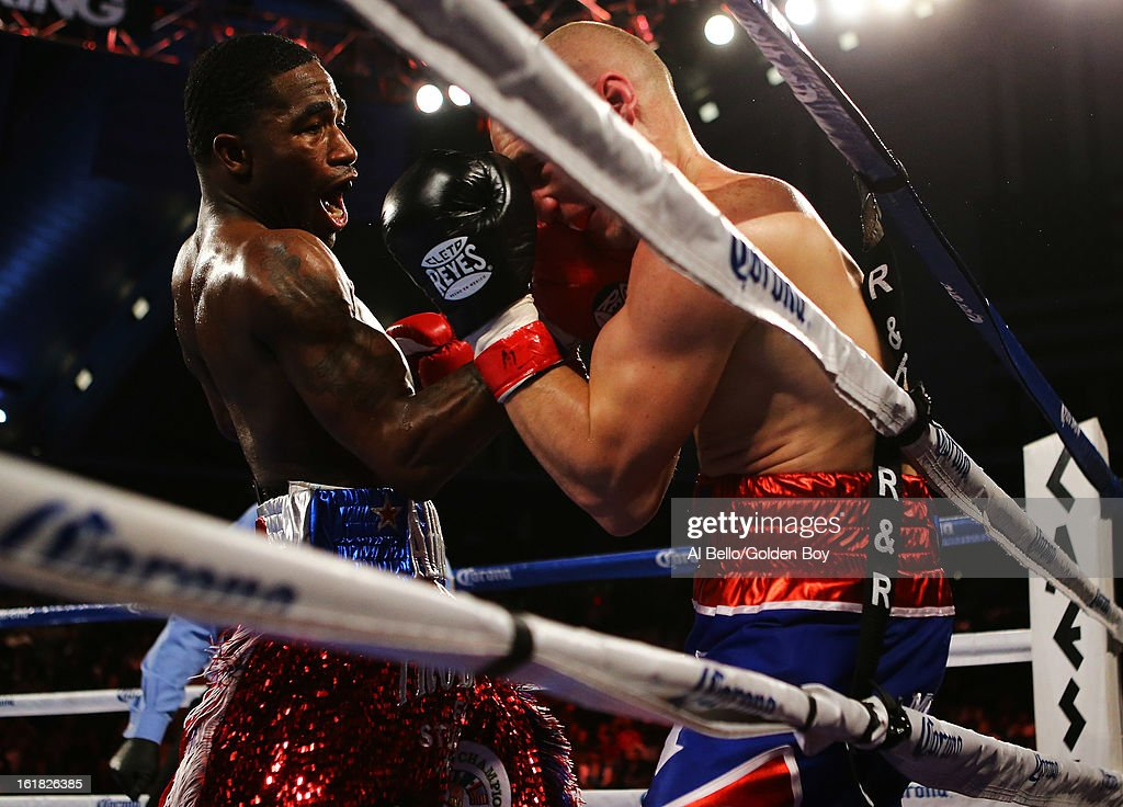 Adrien Broner punches Gavin Rees during their WBC Lightweight Title fight at Atlantic City Boardwalk Hall on February 16, 2013 in Atlantic City, New Jersey.